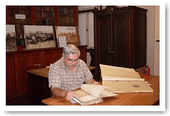 A researcher busy with a manuscript in the Africana Library, paper conservation